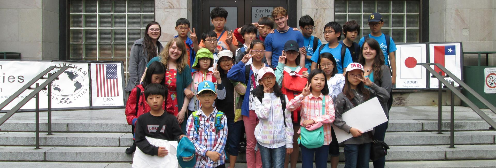 ​Visitors from Cheongju, South Korea, on the steps of City Hall<br> image